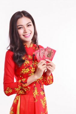 Beautiful Vietnamese woman with red ao dai holding lucky red packet for celebrate lunar new year