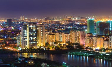 Phu My Hung Distric 7, Nam Sai Gon, Ho Chi Minh city night view with many new buildings aross the riverbank