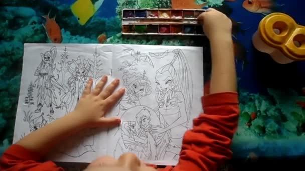 Child paints watercolors