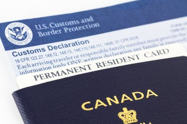 Canadian passport, permanent resident card and form.