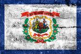 Vlajka West Virginia státu, namalované na špinavé zdi