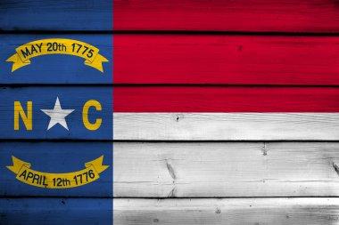 North Carolina State Flag on wood background