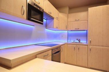 Modern luxury kitchen with purple LED lighting