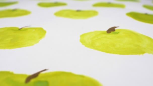 detailní záběr. pozadí jablek namalovaných akvarelem na listu papíru