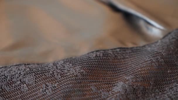fabric as background. 4k, slow motion, black lace and skin
