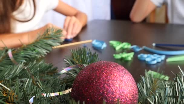Creative paper Christmas tree. Quilling. childrens hands make quilting crafts for the new year. 4k. copy space, close-up Slow motion