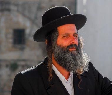 JERUSALEM -JANUARY 18, 2007: Orthodox Jewish Man by the Western Wall in Jerusalem, Israel. stock vector