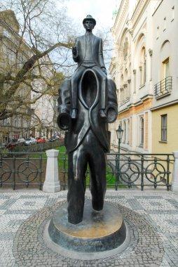PRAGUE, CZECH REPUBLIC - JANUARY 10, 2007: Franz Kafka statue located in Jewish quarter of Prague, Czech Republic. Kafka was a German language writer of novels and short stories born on 3 July 1883. stock vector