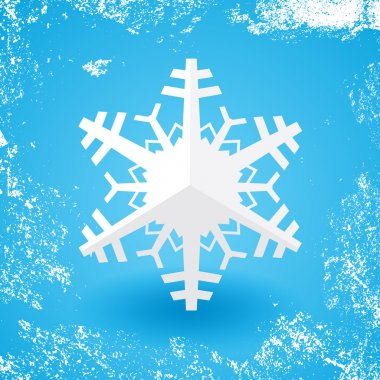 White paper christmas snowflake on a blue background with shadow and white snow grunge