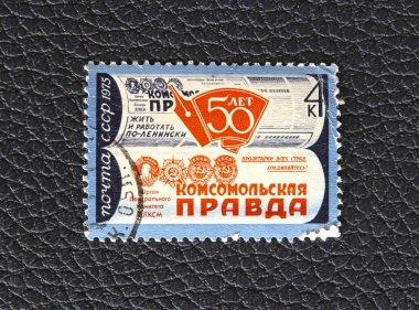 A stamp printed in the USSR, dedicated to the 50 years of newspaper Komsomolskaya Pravda, circa 1975