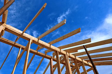 Installation of wooden beams at construction the roof truss syst