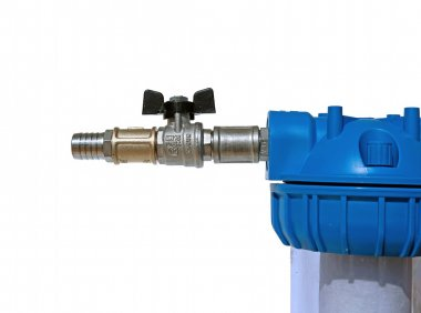 Nickeled fittings and nipple on the water filter isolated