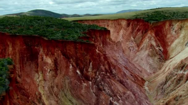 Retreating aerial footage of red brown terraced fields, rural and natural landscape in Ethiopia