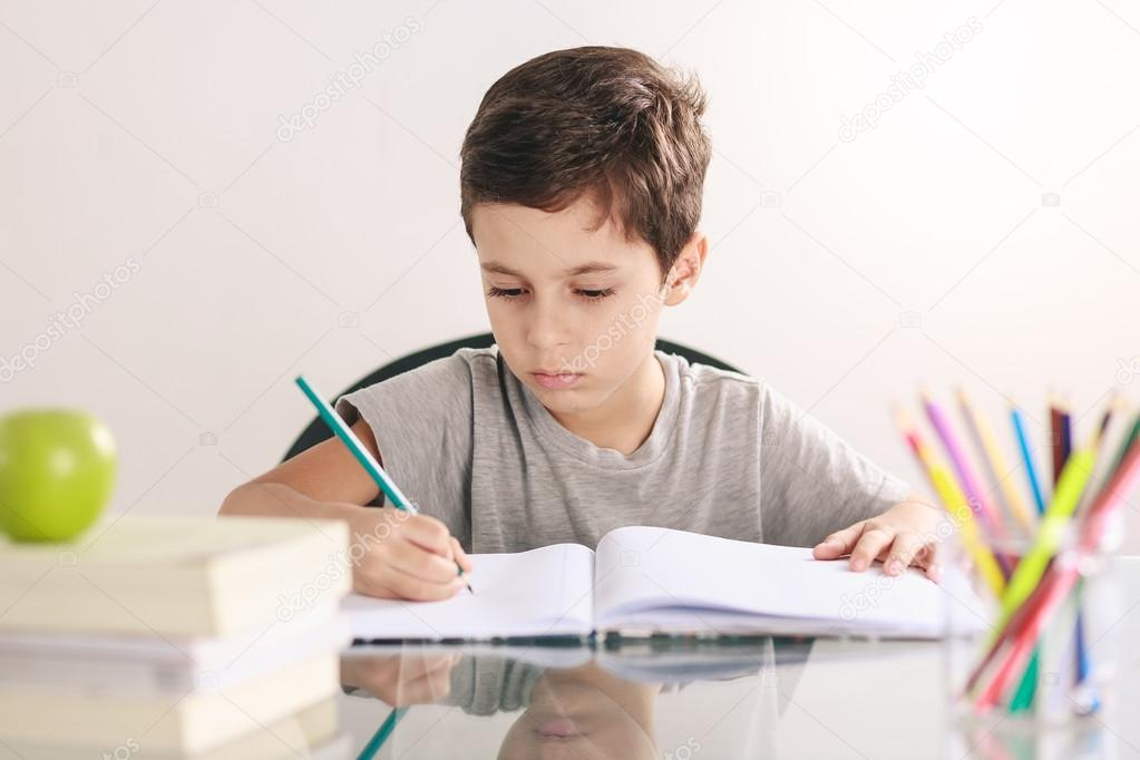 Little boy doing his homework.
