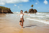 Photo Woman in Tambaba Beach in Brazil, known for allowing the practice of nudism / naturism