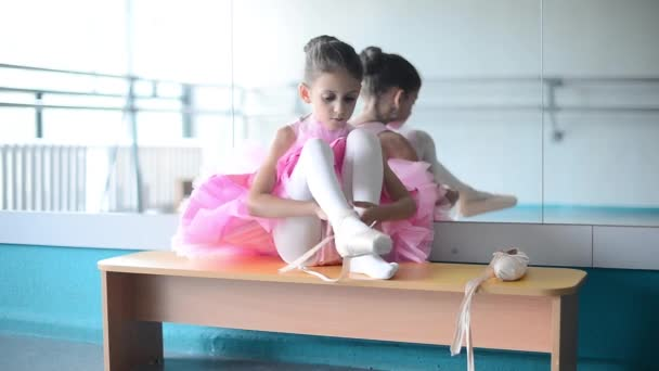 little ballerina in pointes  in the ballet hall