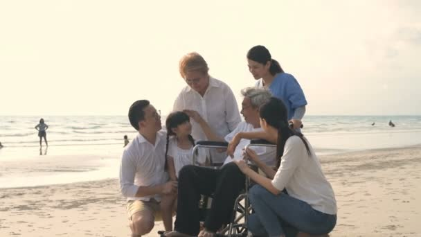 Holiday concept. All family members are enjoying the beach. 4k Resolution.