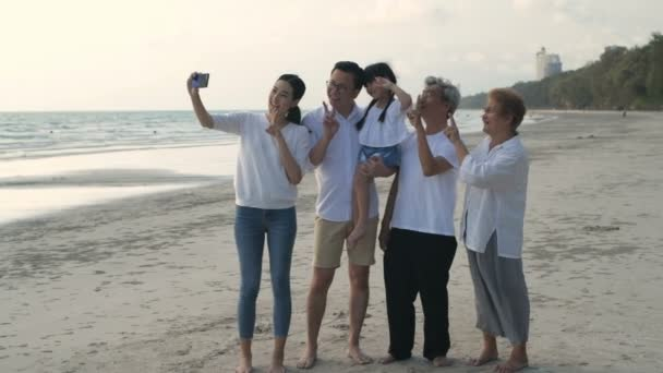 Holiday concept. Every family member is taking a photo together at the sea. 4k Resolution.