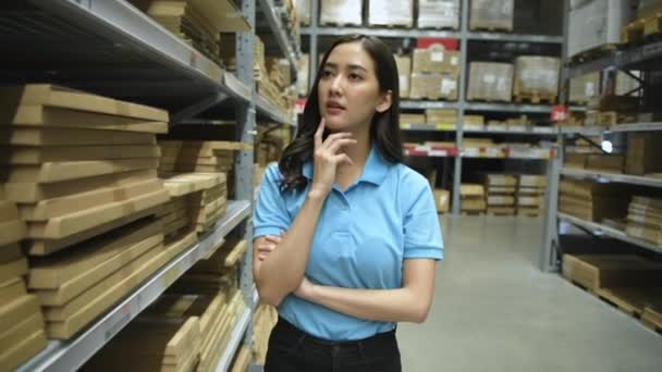 Business concept of 4k Resolution. Asian girls are looking for goods in the warehouse.