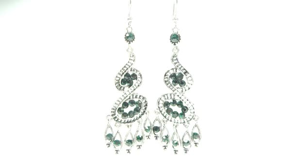 Jewelery earrings with green emerald gem bright crystals
