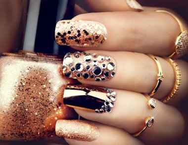 Golden holiday style bright manicure
