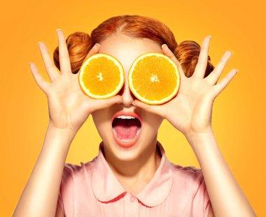 model girl takes juicy oranges