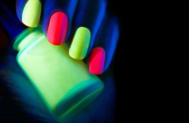 model woman nails in neon light