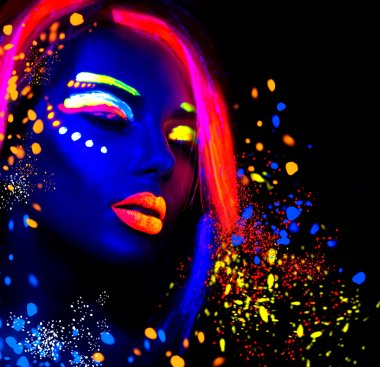 Fashion model woman in neon light