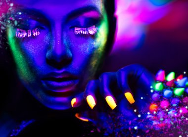 Fashion woman in neon light