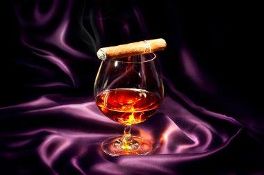 Cognac and cigar.