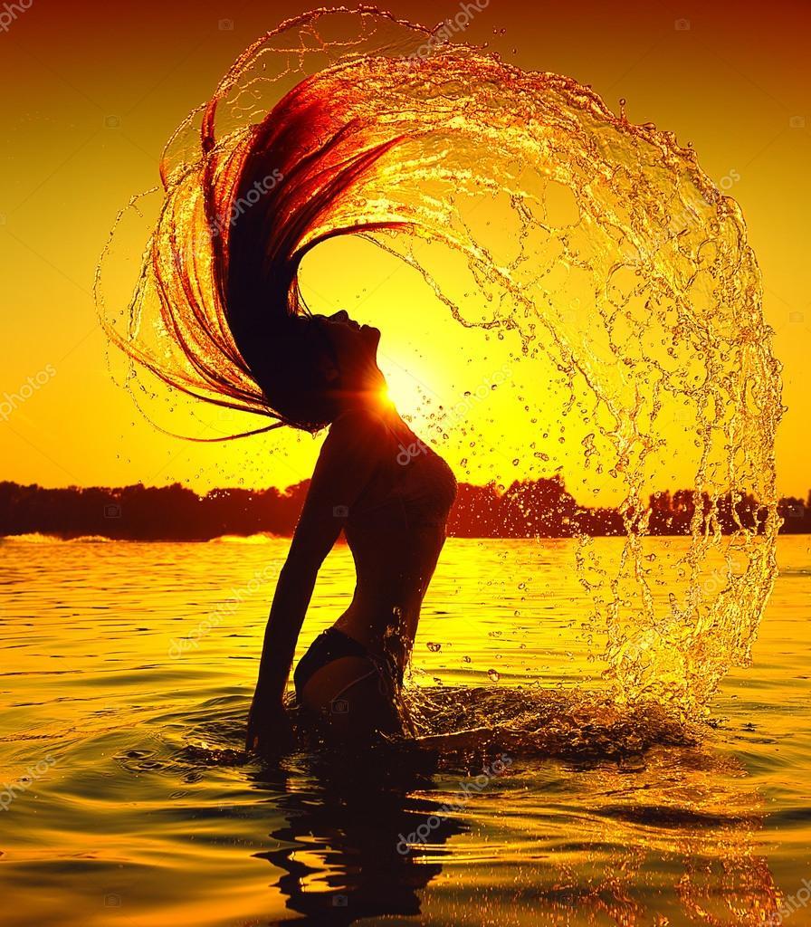 Girl splashing water with hair