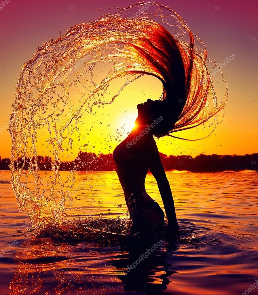 Girl splashing water with her hair