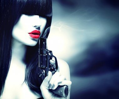 Sexy model woman with  gun.