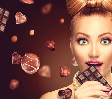 Beauty  girl eating chocolate