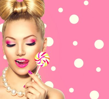 fashion model girl eating  lollipop