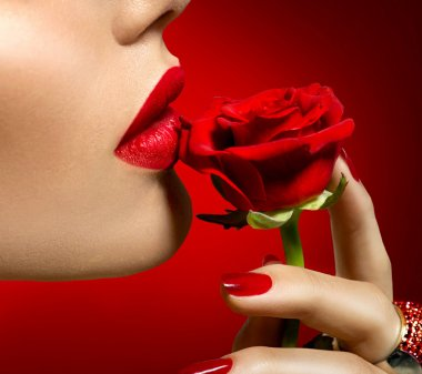 woman kissing red rose flower.