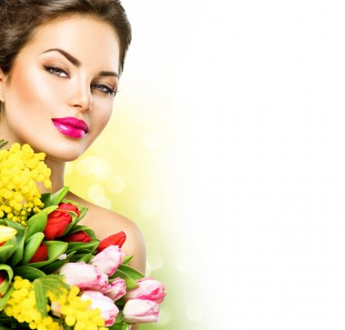 Beauty  woman with  flowers bouquet