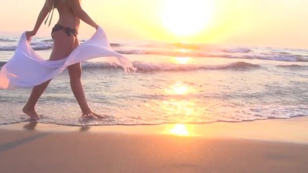 girl going for awalk along coastline