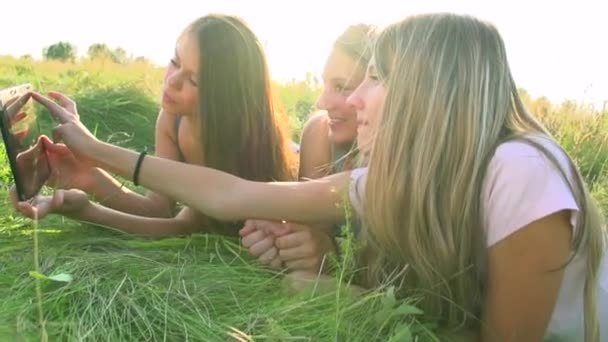 Girls with  touchpad outdoors