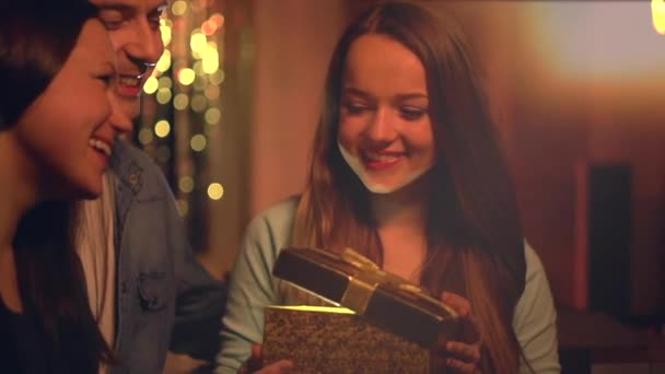 Parents presenting  surprise gift to  daughter