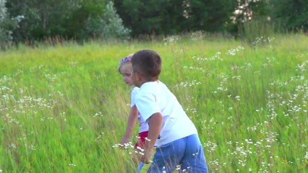 Kids Running on Green Field