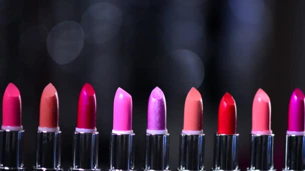Lipsticks blinking bokeh background.