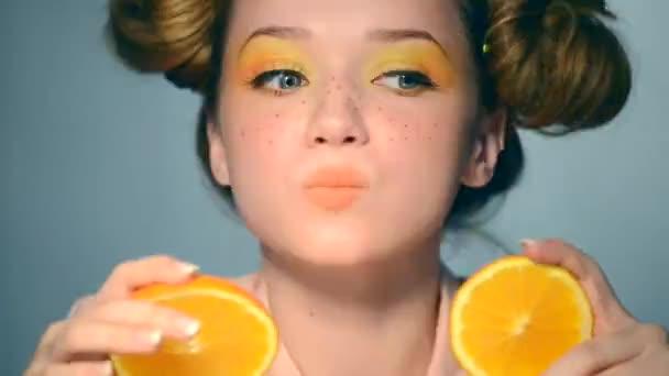 teen girl takes juicy oranges