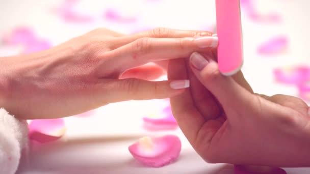 Woman in  beauty salon receiving  manicure
