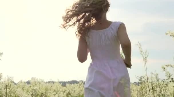 joyful young woman outdoors.