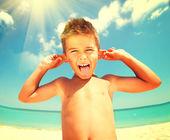 Fotografie Joyful boy having fun at  beach