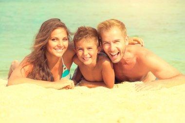 Happy family having fun at  beach.