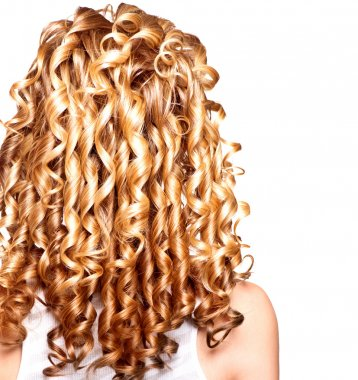 Beauty girl with blonde curly hair.