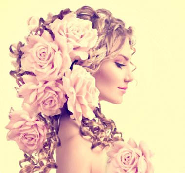girl with rose flowers in hairstyle