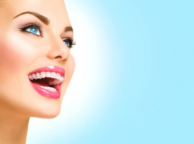 Beautiful woman  with braces on teeth